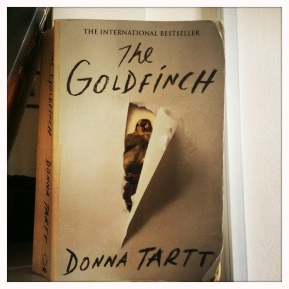 My copy of The Goldfinch (in the time it took to read the dog chewed it and I spilled smoothie on it)